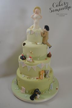 Charli's One of a Kind Wedding Cake - with family Pets, A late groom and Bite taken out of the cake!
