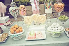 Wedding candy buffet table - circus peanuts, rock candy and saltwater taffy?!? Love it.