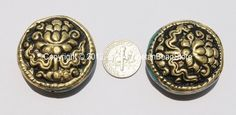 Big Reversible Tibetan Repousse Carved Brass Auspicious Lotus Flower Round Disc Shape Beads with Turquoise Side Inlays Quantity: 2 beads The Lotus is one of the 8 Auspicious Symbols. It represents wis
