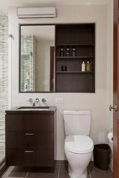 Small bathroom. Compact vanity. Compact toilet. Floating vanity. Faucet from wall, not from counter.