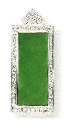 A jadeite and diamond pendant  Set with a semi-translucent rich green jadeite rectangular plaque measuring approximately 30.5 x 12.7 x 4.1mm, surrounded by a frame of princess-cut diamonds with a triangular surmount set with similarly-cut diamonds, mounted in 18k white gold,