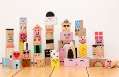 Blocks painted with faces and patterns.