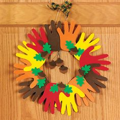 Foam Hand Print Wreath - I think construction paper would be okay for an indoor wreath.