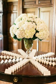 Escort Card Table with Hydrangea | photography by http://www.rebeccaarthurs.com