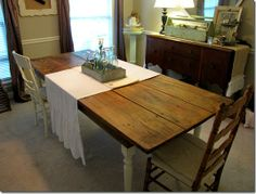 wonderful old table with mismatched chairs & great ruffled runner