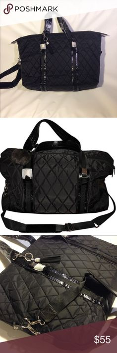 NEW!Quilted Travel tote Shoulder Duffel Bag Unisex NEW! Large quilted weekender bag has patent leather look trim on nylon fabric with two sturdy handles & optional shoulder strap. Inside fully lined w large zipper pocket & open pockets on opposite side. Detachable keychain with imitation leather & diamond-like rhinestones attach to handle. Zipper closer. Each handle is 26 inches long in length. Never been used. Original protective shields in place on handles & silver hardware. As noted on…
