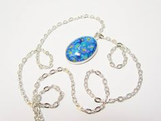 Small Oval Pendant Necklace Forget-Me-Not Hand by turquoiseeye