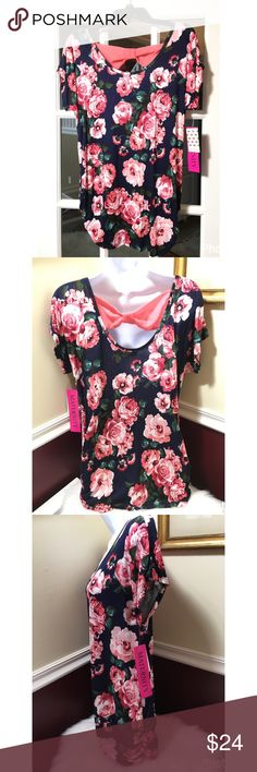 """SaleAdorable Floral Back Bow Maternity Top An adorable but comfy maternity top. Floral print in pinks and blues. (Base color is a dark blue not black) .)With a sheer bow opening on the back. Polyester/Spandex. Very silky jersey material. Sizes: Large approx 21.5"""" flat across and XL 22.5"""", approx 30"""" length . A loose fitting style top. Ruched on bottom of both sides for comfort. Brand new with tags. Free Kisses Maternity  Tops Tunics"""