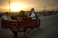 Men rode in the back of a vehicle on the outskirts of Kandahar, Afghanistan, Tuesday. (Anja Niedringhaus/Associated Press)