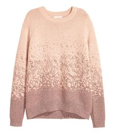Powder/glittery. Long-sleeved sweater in a soft, fine knit with ribbing at neckline, cuffs, and hem. Slightly longer at back.