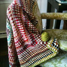 Large granny square blanket made from leftover balls of fingering from knitting projects. I'm loving the gradual color shifts. #ldjcrochethookup #grannysquaresrock #crochetersofinstagram #crochetblanket by debinpt
