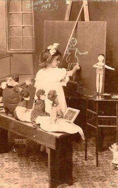 Vintage llittle girl playing pretend art class with her dollies. This is so precious!