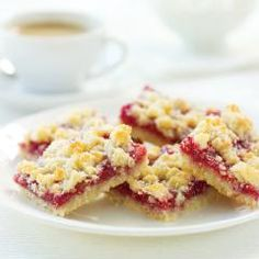 "Raspberry Streusel Bars:  Streusel is German for ""sprinkle"". Unusually, the streusel topping for this delectable raspberry bar is the same mixture as the pastry base of the bar."