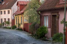 Photographs from inside the ring wall in Visby town on the Island of  Gotland. Visby is a beautiful city with narrow roads and lots of colorful  houses and shops, all within a walking distance. The best time to  photograph the streets are early in the morning.