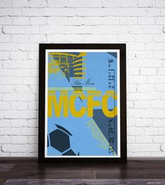 This is a stylish Manchester City FC framed poster print, fit to grace any man cave or childrens bedroom. Styled with typography it features the stadium coordinates and legends from this iconic team. CAN BE PERSONALISED BY ADDING YOUR/THE RECIPIENTS NAME TO THE PLAYERS LIST.