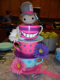 DIY Tea Party Centerpieces - Dollar Store Oversized tea cups/saucers... craft paint, gloss finish, fake flowers and adhesive glue. Ta-Dah!