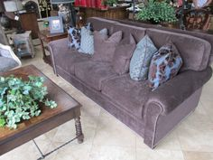 Wonderful new cozy chocolate chenille sofa with chrome nail head trim and 6 down filled accent pillows. This new piece is priced at just $3999.00