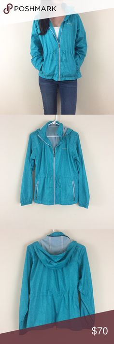 """Columbia light weight windbreaker rain jacket Med Columbia light weight windbreaker rain jacket. Teal with a fun geo pattern. Perfect condition. Mesh lining. Zips up, hooded and has drawstrings at waist. Size Medium. 20.5"""" pit to pit and 26"""" long. Columbia Jackets & Coats"""
