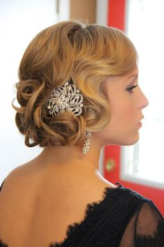 Don't be afraid to adorn your glamorous 'do with a clip or pin. @myweddingdotcom