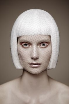 White geometric bob haircut with bangs