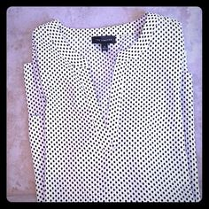 ✨THE LIMITED tunic style top THE LIMITED tunic style top with asymmetrical, layered bottom.  Ivory color with black polka dots.  Sleeves are 3/4 length, but can be cuffed and buttoned to short sleeved.  Perfect length to wear over leggings.  100% polyester, machine washable. Only worn a couple of times, excellent condition. The Limited Tops Tunics