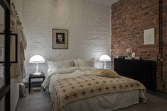 Loft bedroom with exposed brick