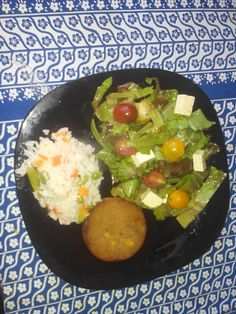 Lentils burger, rice and salad
