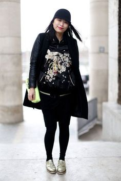 Très Chic! The Best Street Style at Paris Fashion Week: The eye-catching embroidery on this showgoer's varsity jacket juxtaposed a baseball cap and oxfords.