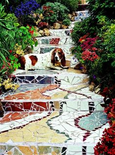 Add personality to your garden with easy mosaic projects you create from pieces of tile, pottery and glass. I'd like to do something like this to our back garden stairs.