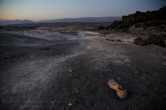 Photograph by @johnstanmeyer  A shoe belonging to a man lost on his quest for a better life in the desert know as Ardoukoba in Djibouti. Each year more than 100000 other men women and children from Ethiopia Eritrea and Djibouti walk through this ancient laval field in hopes of reaching the Red Sea traveling then with smugglers by boat to Yemen and Saudi Arabia in hopes of work or passage further into Europe for a better life.  In humility and respect at this poignant point in history when…