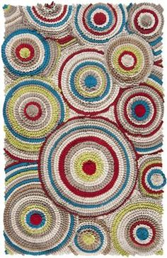 Vibrant wool rug with bold circles from Surya's Moral Collection