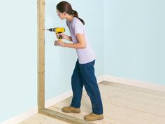 DIY Network has instructions and photos for building a non-loadbearing stud wall and installing a doorway in it. Building A Stud Wall, Load Bearing Wall, Basement Furniture, Build A Wall, D House, Tiny House, Living Room Grey, Living Rooms, Diy Network