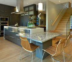 Modern gloss kitchen with Quartz waterfall island countertop and lower dinning table top Waterfall Island, Gloss Kitchen, Island With Seating, Dinning Table, Studio Apartment, Kitchen Countertops, Kitchen Designs, Kitchen Ideas, The Originals