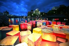 Candles and paper lanterns float on the Motoyasu River in front of the Atomic Bomb Dome at the Peace Memorial Park, in memory of the victims of the bomb on the 62nd anniversary of the Hiroshima bomb, on August 6, 2007 in Hiroshima. Japan. The dropping of the atomic bomb by the U.S. killed an estimated 70,000 people instantly on August 6, 1945 with many thousands more dying over the following years from the effects of radiation. Three days later another atomic bomb was dropped on Nagasaki…