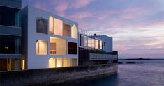 riverfront-homes-contemporary-vacation-house click to see interior