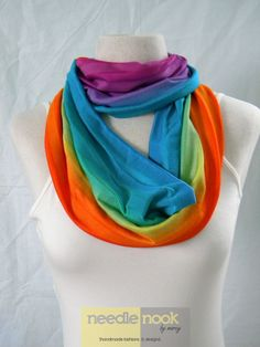 A rainbow-colored scarf to go with almost any outfit... The Rainbow Stripe Infinity Scarf  Jersey by needlenookbymarcy, $16.00