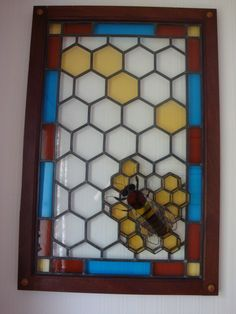 Stained Glass Bee and her honeycomb..made by my very clever Father.. @Kay Taylor you need this!