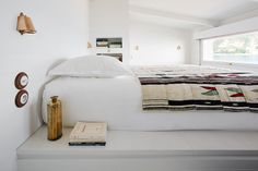 ArchitectsEmil Humbert and Christophe Poyet were faced with a challenge when renovating a seaside cabin, located on the Italian Riviera between Bordighera and San Remo. It was tiny. So small that it didn't even have a toilet. So naturally, they used the rooms of a ship as inspiration to maximize
