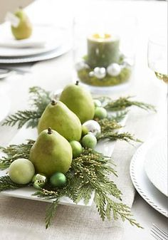 Simplicity- Fruit or veggie as decoration with sprigs of plant/tree branches/twigs & embellishment. This one for the Fall- pears on trays with sprigs of evergreen , add various size and color balls or trinkets. Maybe holly branches & pomegranites for Christmas and ?