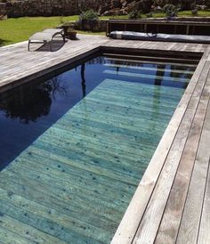 Have you ever seen a wooden pool? With the rise of amazing wood texture tiles (w… Have you ever seen a wooden pool? With the rise of amazing wood texture tiles (we're looking at you Earp Bros) we can't wait for beautiful… Diy Swimming Pool, Natural Swimming Pools, Swimming Pool Designs, Indoor Swimming, Small Backyard Pools, Pool Decks, Piscina Hotel, Indoor Outdoor, Pool House Decor