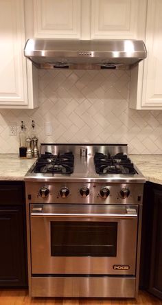 My Black & White Kitchen under $10,000! General finishes java gel stain, nxr range, white river granite, herringbone subway tiles with grey grout.