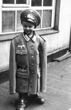 Young German Boy In His Father's Uniform, 1939.