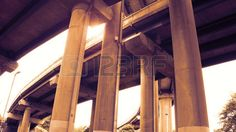 Picture of Curved highway elevated on concrete pillars from a low angle stock photo, images and stock photography.