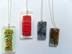 A few of my pendant designs combining laser cut acrylic with weaving and laminated fibres.