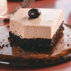 Mocha Cheesecake Bars - 1 serving equals 166 calories.  Made with reduced-fat Oreo cookies, fat-free hot fudge, butter, unflavored gelatin, coffee, reduced-fat cream cheese, sugar, reduced-fat sour cream, bittersweet chocolate, chocolate-covered coffee beans.
