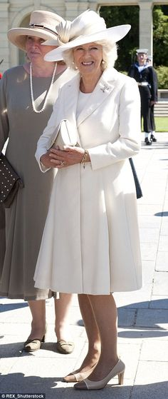 The white stuff: Camilla, seen here in Papua New Guinea in 2012 and in Normandy last year, has embraced a paler palette