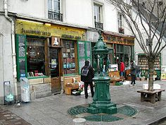 Google Image Result for http://smarttravelinfo.com/wp-content/uploads/2011/12/300px-Shakespeare_and_Company_store_in_Paris.jpg