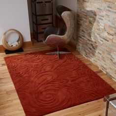 Relief Paisley rugs feature a contemporary paisley design which has been skilfully hand carved from the deep terracotta coloured pile.