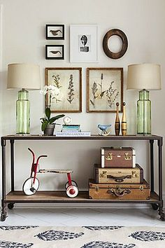 love that console table and the green lamps.