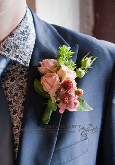 Dusky pink rose and berry buttonhole.